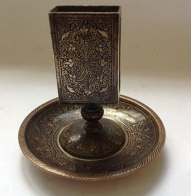 A vintage decorative ashtray and match box holder in brass.