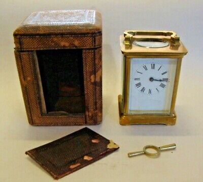 Early 20th century brass cased carriage clock with leather covered travel case