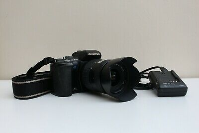 Used Olympus EVOLT E-500 DSLR camera body with 14-45mm kit lens, hood + charger