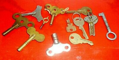 group of vintage/antique clock keys and others