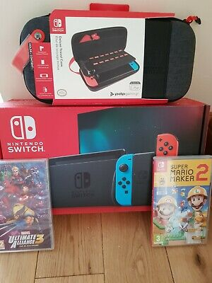 Nintendo Switch Console With 2 Games And Deluxe Travel Case
