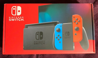 NEW Nintendo Switch with Neon Blue and Neon Red Joy‑Con IN HAND