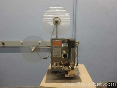 Tuck Industries Inc. Automatic Labeler
