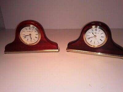 Two Small Howard Miller Mantal Clocks brass and one  cherry color other darker