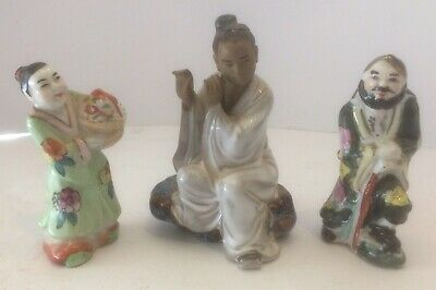 vintage Chinese mudman figure playing flute and 2 small male/female figurines