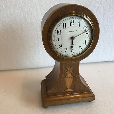 Ballon inlaid mahogany cased mantle clock
