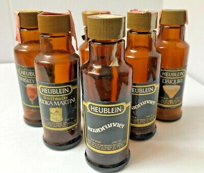 Vintage Heublein Set of 6 Mini Glass Bottles with caps and tax seals