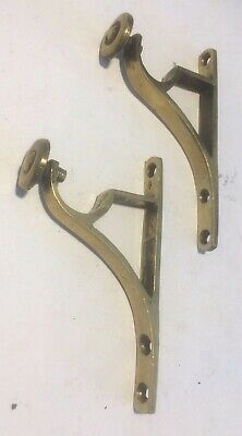 vintage brass curtain pole brackets with small circular design