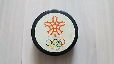 4 Eishockey Pucks, Olympic Games 1988, 1992, 2002, 2006