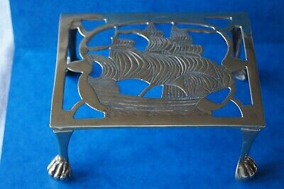 Antique Brass 4 legged trivet /stand with sailing ship design