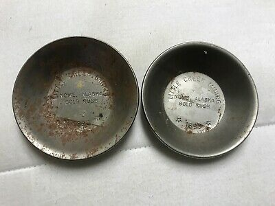 Pair of souvenir mining pans...Little Creek Mining, Nome, Alaska